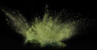 Coloree el polvo estallado, aislado en el ambiente del control Fotos de archivo