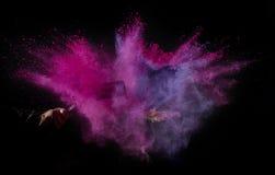 Coloree el polvo estallado, aislado en el ambiente del control Imagen de archivo