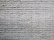 Coloree la fotografía del detalle de la pared de ladrillos coloreada blanco Imagenes de archivo