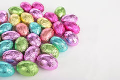Colorefd easter eggs over white Stock Photos