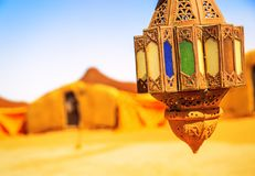 Coloreful berber lamp with traditional nomad tents on background. Closeup view on coloreful berber lamp with traditional nomad tents on background Royalty Free Stock Photography