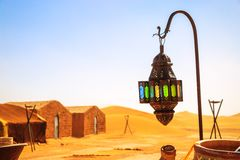 Coloreful berber lamp with traditional nomad tents on background. Closeup view on coloreful berber lamp with traditional nomad tents on background Stock Images