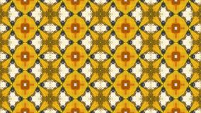 colores amarillos del fondo del mosaico del caleidoscopio y anaranjados video cambiantes animados abstractos
