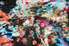 Colores borrosos cerosos hipnóticos vivos de la pintura colorida oscura, contrastes, fondo creativo ceroso Imagen de archivo libre de regalías