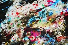Colores borrosos cerosos vivos del puple oscuro del rojo anaranjado, contrastes, fondo creativo ceroso Imagen de archivo libre de regalías