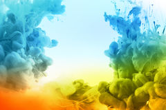 Colores de acrílico en agua Foto de archivo libre de regalías