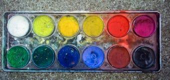 Colores de agua en caja Fotografía de archivo