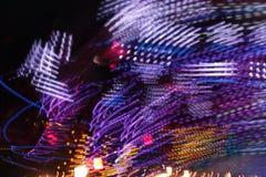 Colores de la noche del parque de atracciones Imagen de archivo libre de regalías