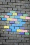 Colores de la tiza en ladrillo del pavimento Imagen de archivo libre de regalías