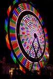 Colores del arco iris de la rueda de Ferris en la noche Fotografía de archivo libre de regalías