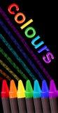 Colores del creyón sobre negro Imagenes de archivo