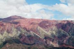 Colores di Cerro de siete, montagne di colore rosso Fotografia Stock