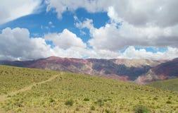 Colores di Cerro de siete, montagne di colore rosso Immagine Stock Libera da Diritti