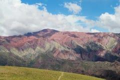 Colores di Cerro de siete, montagne di colore rosso Fotografie Stock