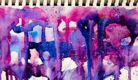 Colores que fluyen en cuaderno Imágenes de archivo libres de regalías
