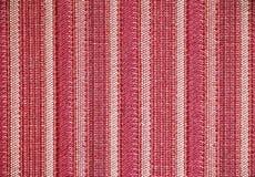 Colores rojos y blancos de la textura de la tela de la raya Fotos de archivo