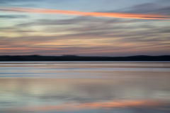 Colores vibrantes del paisaje abstracto de la puesta del sol de la falta de definición Foto de archivo libre de regalías