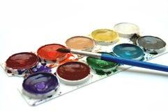 Colores y cepillo Foto de archivo libre de regalías