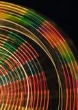 Colores y contornos de una rueda de Ferris Imagen de archivo libre de regalías