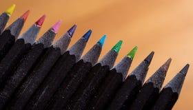 Colorez le bois noir de crayons Photographie stock