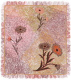 Colorfu weavel carpet with floral applique and  fringe in pastel Royalty Free Stock Image