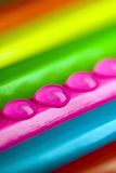 Colorful. Four tiny water drops on colorful pencils Royalty Free Stock Photos
