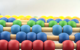 Colorful abacus beads, macro image Stock Photo