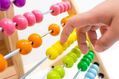Colorful abacus children toy hand playing. For practice math and calculation learning for kids royalty free stock images