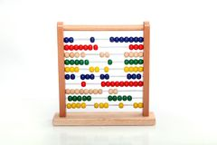 Colorful abacus on white background in the studio stock photos