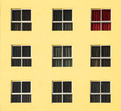 Colorful abandoned building with red curtains Stock Images