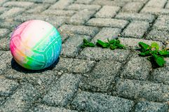 Colorful, abandoned voleyball on rough old pavement stock images