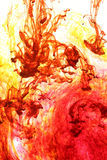 Colorful abstract background. Of swirling red and yellow inks royalty free stock photography