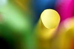 Colorful abstract background with blur effect. Close-up of a drinking straw end with a blur effect on a colorful background Stock Photo
