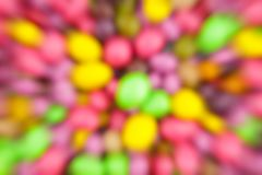 Colorful abstract background blurred dragee candy yellow pink speed movement festive foundation design stock illustration