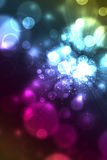 Colorful abstract background of bubbles. Colorful abstract background of glowing light bubbles like bokeh Royalty Free Stock Photo