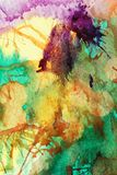 Colorful abstract background. In green, yellow and purple with paints applied using compressed air stock illustration