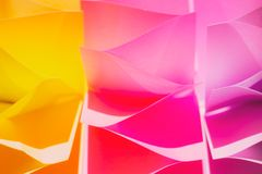 Colorful abstract background, made of paper stickers. In pink and yellow color stock photos