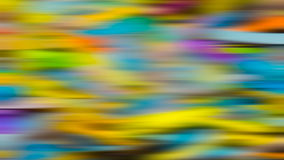 Abstract background with colorful stripes in motion. Bright festive texture with showy iridescent blurred colors causes a 3D sense. Optimistic modern style stock photography