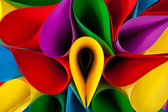 Colorful Abstract. Colorful card stock in unique elliptical shapes with shadow effect and selective focus on a black background Stock Photography