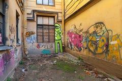 Colorful abstract graffiti patterns on damaged walls Royalty Free Stock Photography