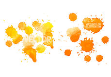 Colorful abstract hand drawn watercolour aquarelle. Yellow orange art drop splatter stain paint on white background Stock Images