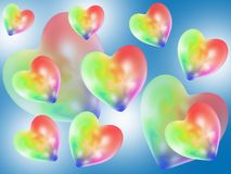 Colorful abstract hearts. Multicolored hearts flying on a blue background Stock Photography