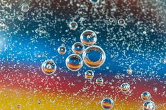 Colorful, abstract oil bubbles on water. Focus on the small bubbles, image for background use Stock Image