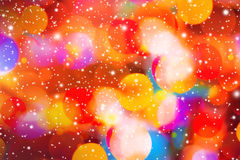 Colorful Abstract pattern winter season backgound. With glowing bokeh light and snowflakes royalty free stock photo
