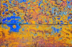 Colorful abstract plating. Aged and rusted the plating from a 1930s locomotive make for a colorful pattern of riveted metal Royalty Free Stock Photo