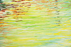 Colorful abstract rippled water Stock Images