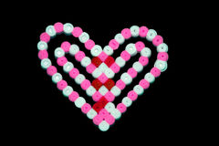 Colorful abstract shape of plastic beads pieced by child Stock Photos