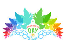 Colorful abstract silhouettes of doves with olive brunch. Illustration of international peace day, September 21. Element design for poster, greeting card Stock Photo
