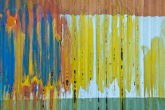 Colorful Abstract Tin Shed Paint Colors Background. An old tin shed is full of colors from paint. Makes for a colorful abstract background with a unique texture Stock Images