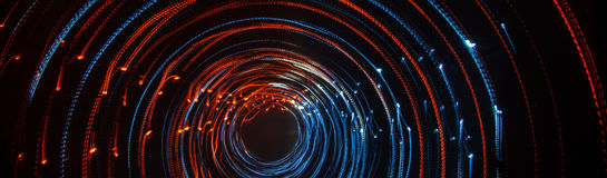 Colorful abstract trails of light. Dots, lines and bokeh on dark background. royalty free stock photos